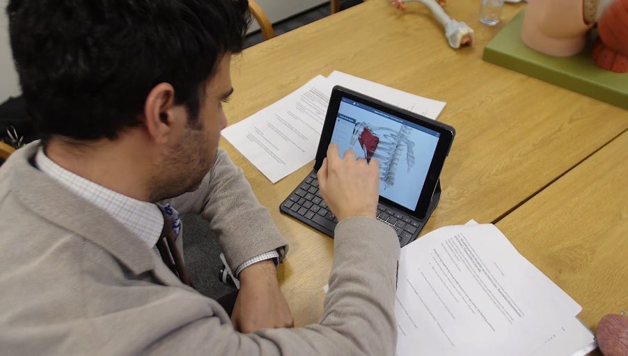 student using Complete Anatomy with iPad