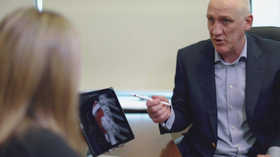 Dr. Neligan explaining a patient's pathology using Complete Anatomy